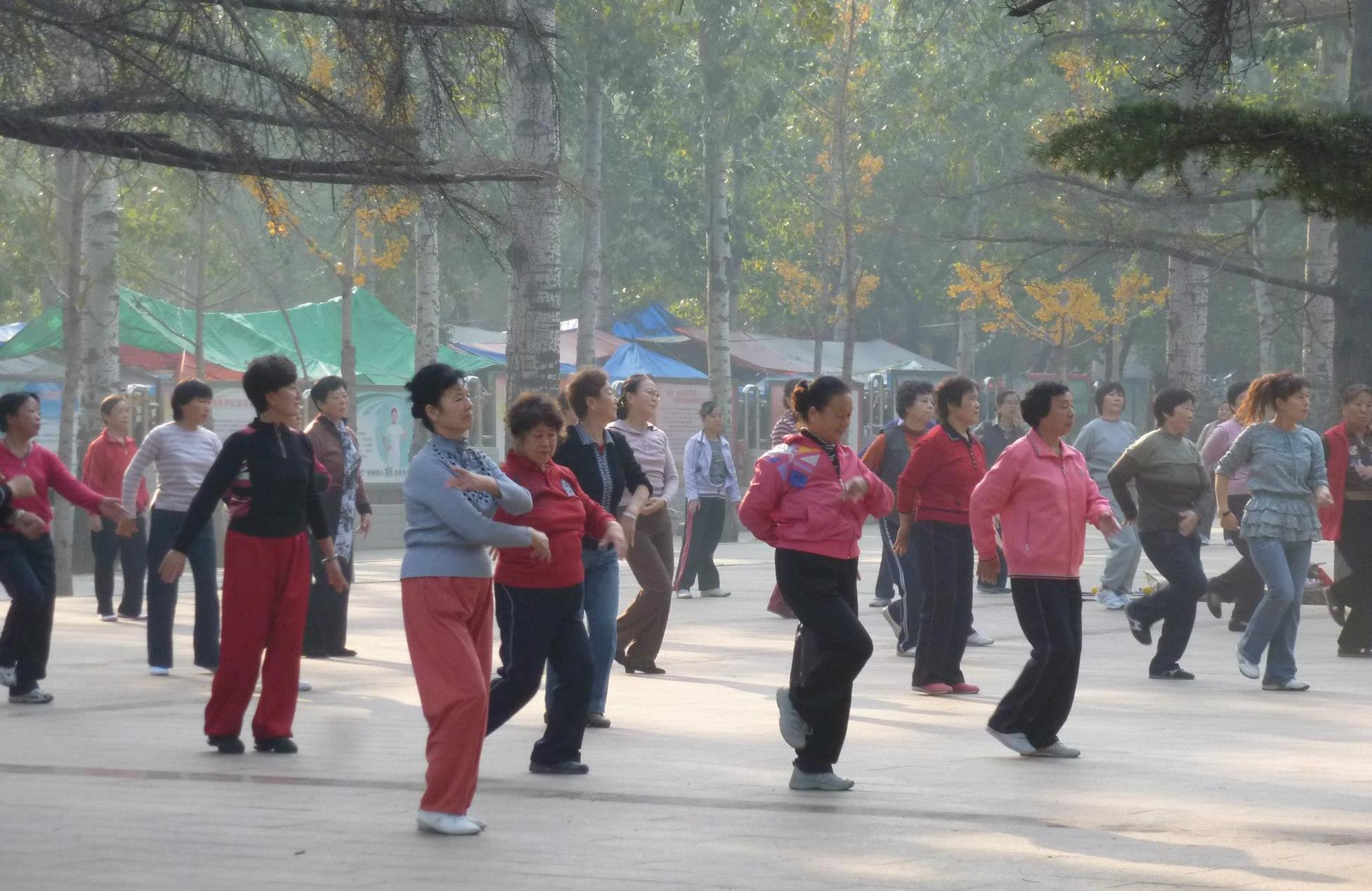 Throughout China women gather to exercise