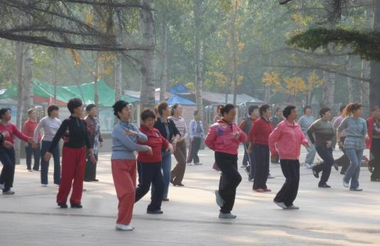 Throughout China women gather to exercise
