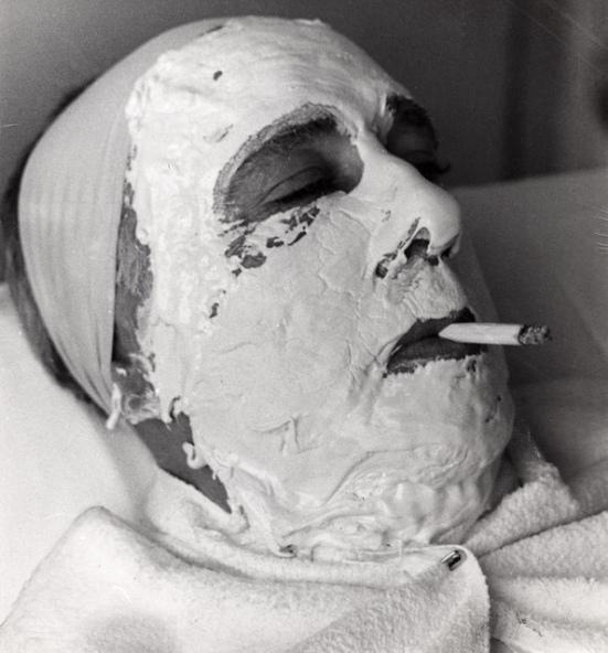 The facial mask resembles a death mask.
