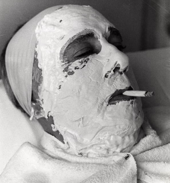 The facial mask resembles a death mask.