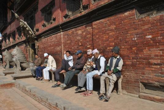By a temple wall, Kathmandu, Nepal
